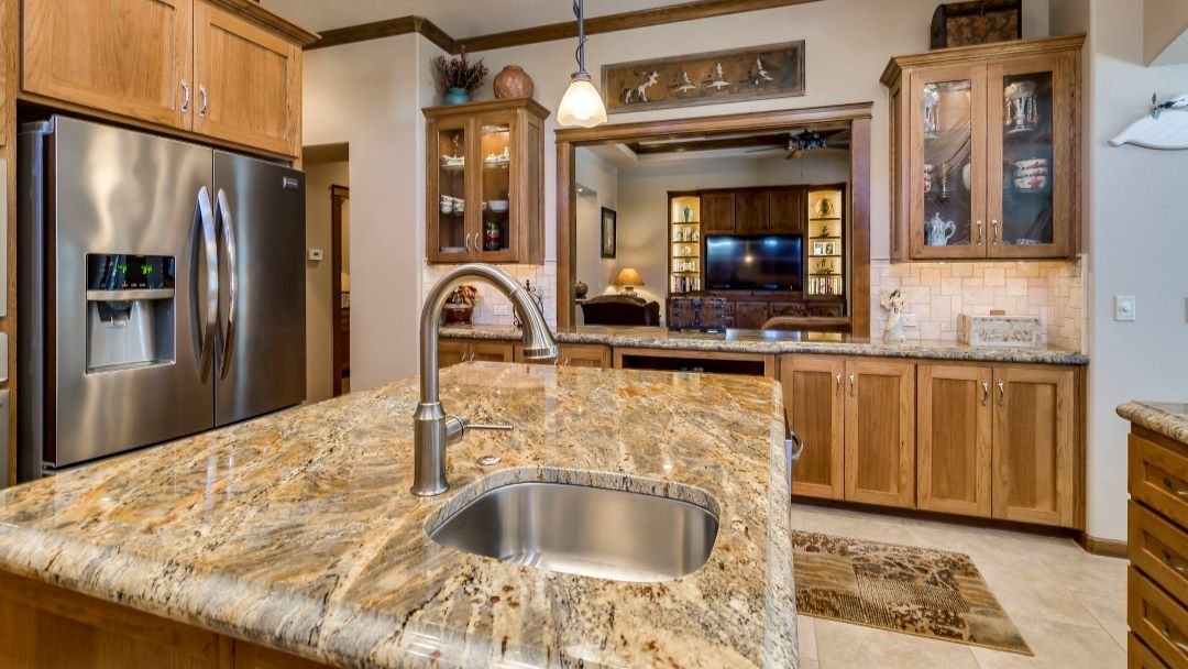 photo of a custom kitchen with granite countertops